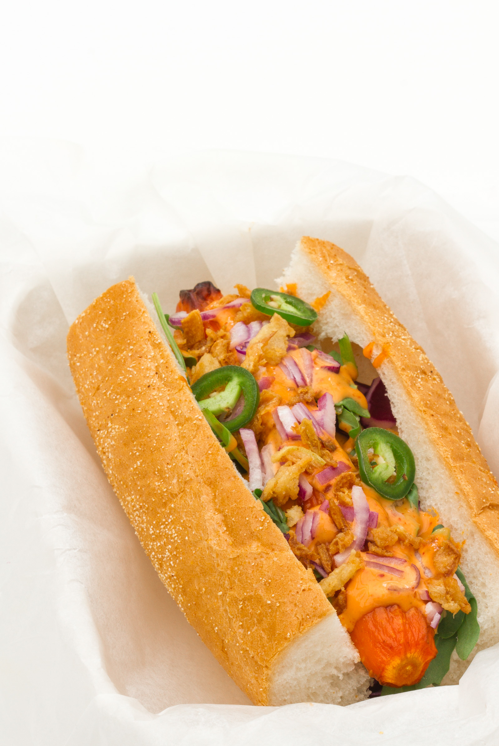 Veggie hot dog with miso-sriracha mayo