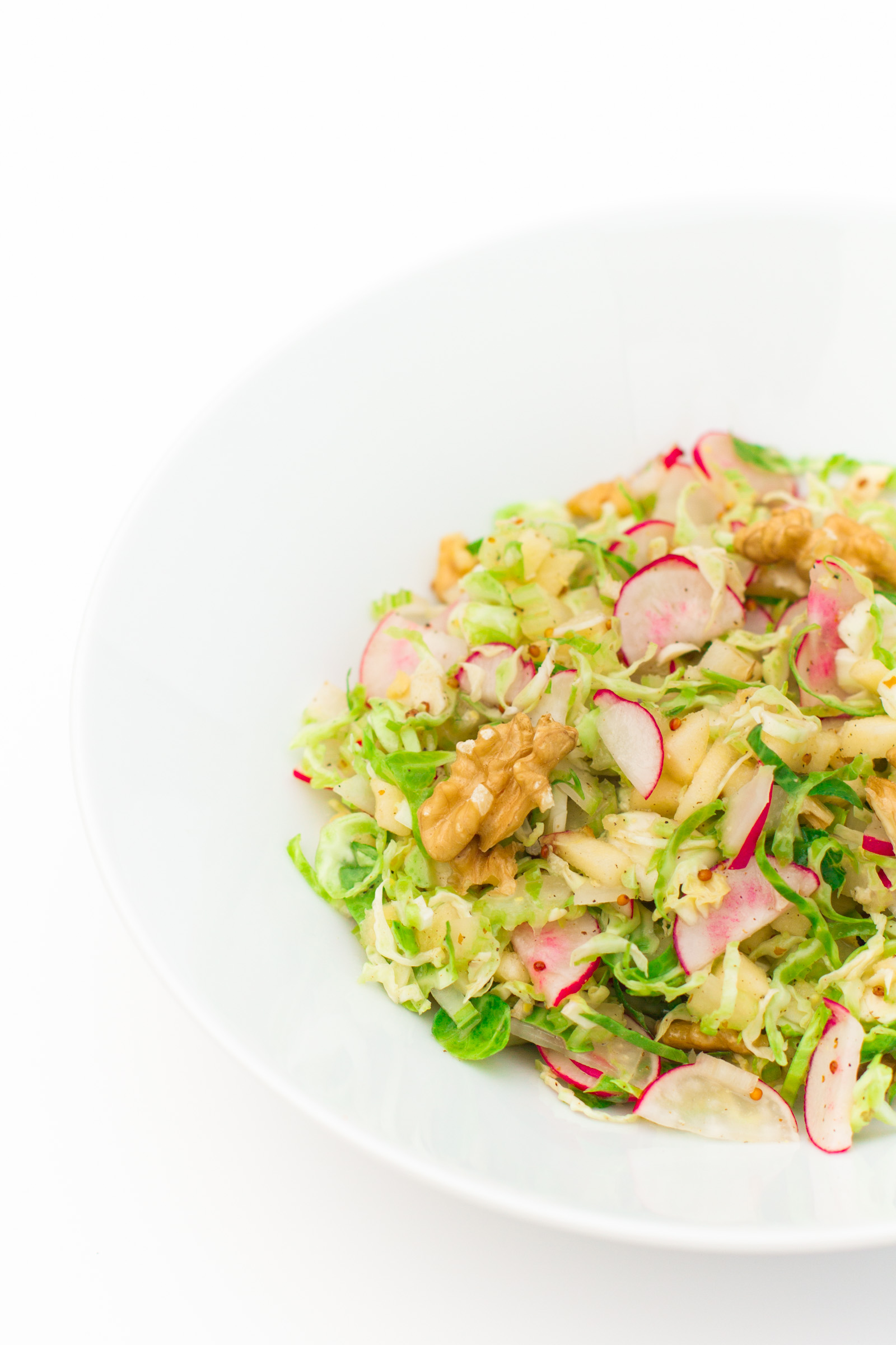 Salad of shaved Brussels sprouts with apples and walnuts